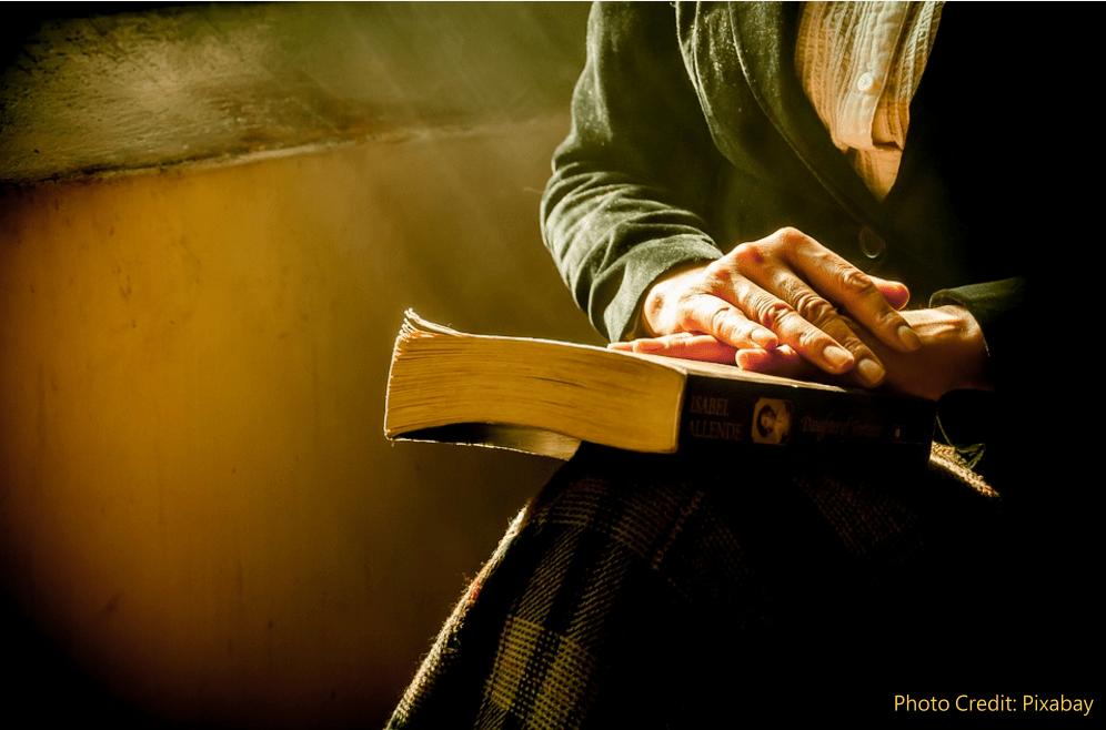 https://pixabay.com/en/book-hands-reflecting-bella-1421097/