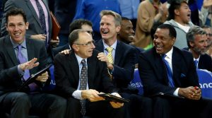 (left to right) Golden State Warriors' coaches Luke Walton, Ron Adams, Steve Kerr, Jarron Collins (2nd row), Alvin Gentry and Bruce Fraser (2nd row) enjoy a block by rookie James Michael McAdoo in 4th quarter of Warriors' 122-79 win over the Denver Nuggets during NBA game at Oracle Arena in Oakland, Calif. on Monday, January 19, 2015.
