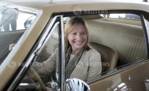 General Motors Co's Chief Executive Officer Mary Barra sits in a 1967 Camaro before the official debut of the all-new Chevrolet 2016 Camaro SIX at Belle Isle in Detroit, Michigan May 16, 2015. REUTERS/Rebecca Cook